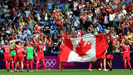 Canada's Olympic bronze medallists in women's soccer soak up the applause at City of Coventry Stadium in Coventry, England, following a 1-0 victory over France on Thursday. (Stanley Chou/Getty Images)