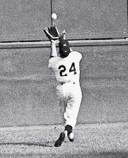 "Willie Mays (New York Giants) making ""The Catch"" to rob Vic Wertz (Cleveland Indians) of a hit in Game 1 of the 1954 World Series."