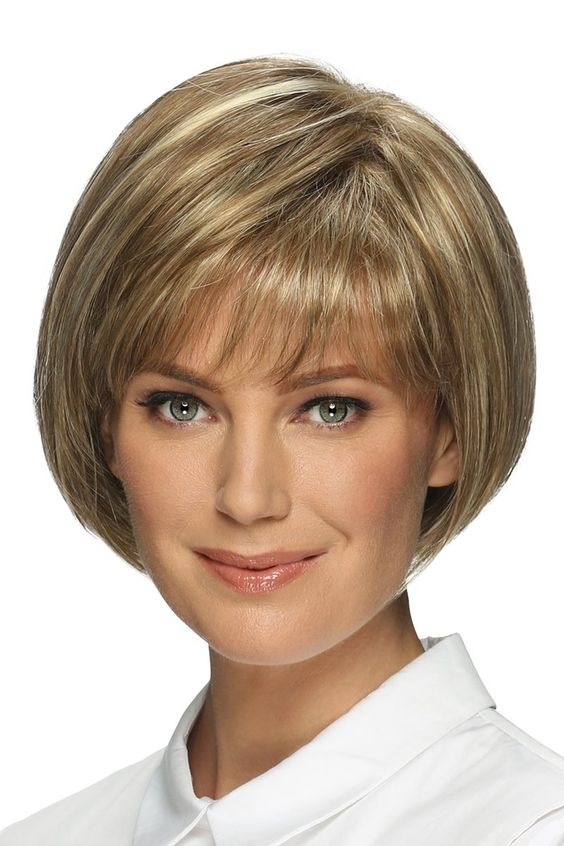 It has never been easier to transition your look from work to play thanks to Ellen's incredible versatility. Full of charming personality, this classic bob style is guaranteed to be one of your favorites. Chin length bob with full bangs and shaped back. Features include super thin and resilient dual elastic sides and a