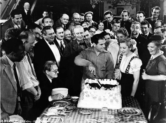director Frank Capra celebrates his birthday on the set of YOU CAN'T TAKE IT WITH YOU