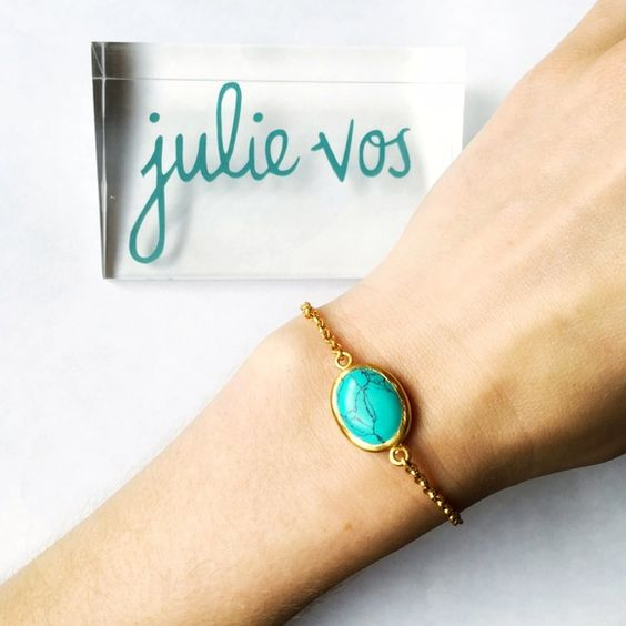 Turquoise and Gold Bracelet This Julie Vos bracelet is such a cool and simple piece. The turquoise stone is absolutely stunning against the 24 karat gold plate setting. The bracelet can be adjusted to fit even the smallest of wrists, with 3 different sized settings on the chain! I love it on its own, but would look just as amazing with stacked bangles of more turquoise and gold!! Julie Vos Jewelry Bracelets