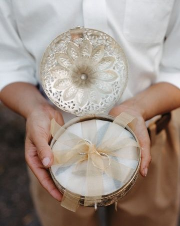 I want to find something like this....gotta check with the fam-damiles!  {A vintage silver chest that once belonged to the bride's great-grandmother carried rings down the aisle at this real wedding}