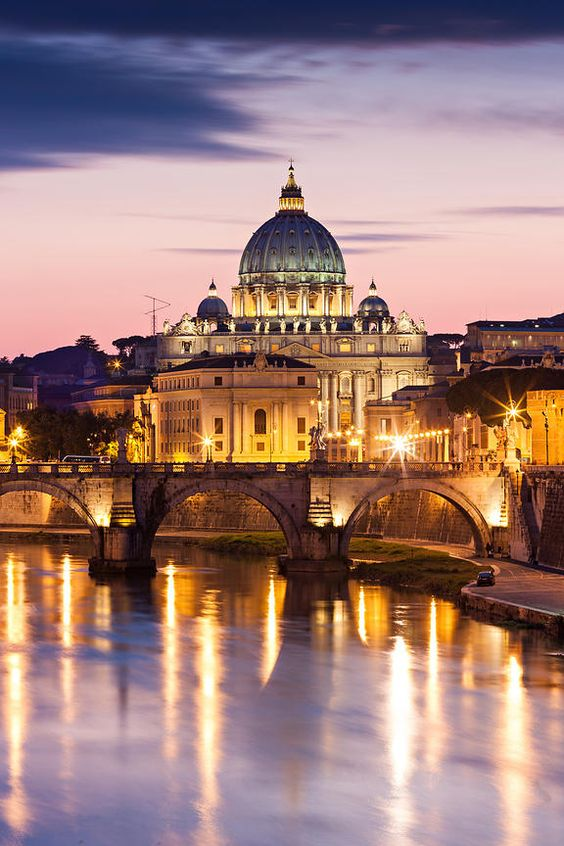 St Peter's Basilica in the twilight, Rome, with light reflections on the Tiber River