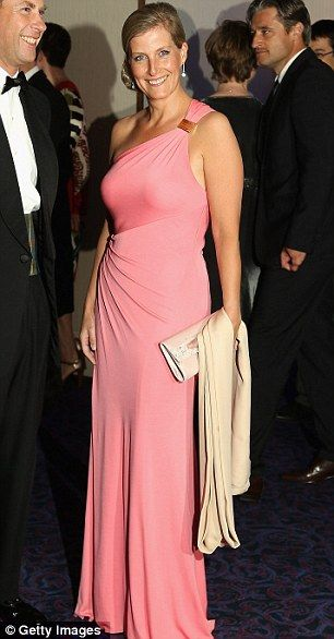 Sophie, Countess of Wessex wore a coral off-the-shoulder dress with sparkling accessories and cream shawl to the ParaOlympic ball.