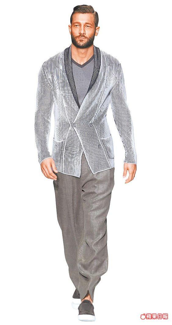 西裝外套輪廓流暢。  美聯社