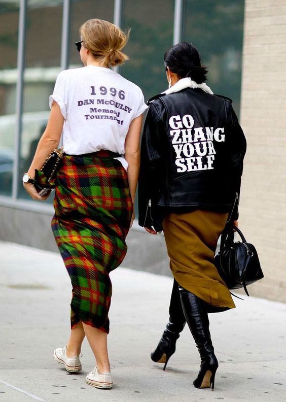 "Street Style: Fall Outfit Inspiration from #NYFW 2015 - Personalized leather jackets are trending. Margaret Zhang wearing a ""Go Zhang Yourself"" Leather bomber 