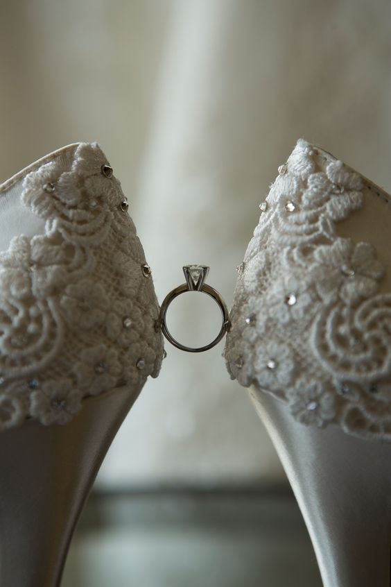 Close up - Bridal shoes with engagement ring
