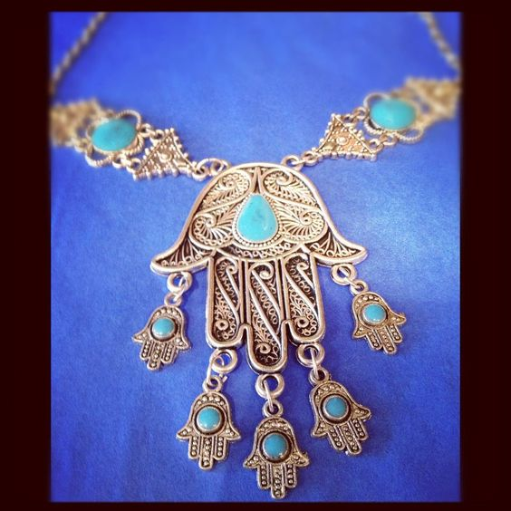 hand of fatima necklace to ward off bad spirits and the