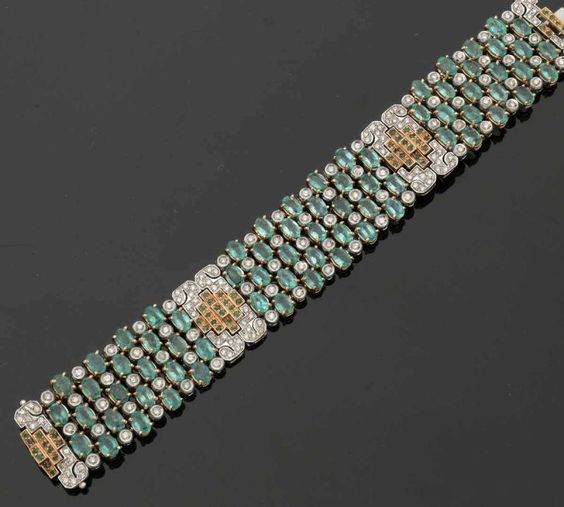 Cuff in art deco style  585. GG and WG, gestemp. 71 emeralds in the Oval cut and…