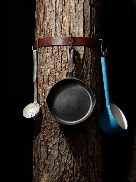 Punch S-hooks through an old leather belt to hang clothes and pans while camping.