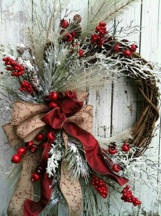 Beautiful holiday wreath with ribbon, berries, and pale greenery. #christmaswreath #holidaydecor