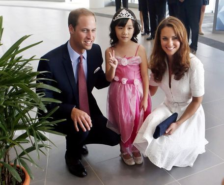 9/12/12 Singapore. 'Princess mad': The Royals accepted a posy of flowers from Maeve Low, aged five, who was picked to make the presentation by the Make-A-Wish Foundation after she was given the all-clear from lymphoma