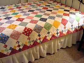 Adorable scrappy diamond patch quilt, love the 9patch on the border too.  So cute and perky.