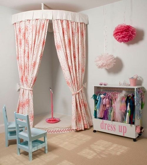 Dress up stage!  Just picked up cute curtains at the thrift store for $2.50!