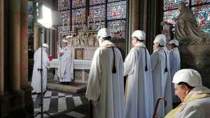 Notre Dame Cathedral holds first mass since fire, with attendees in hard hats