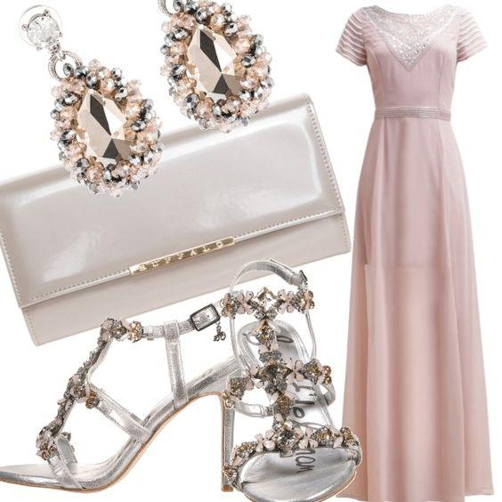 Il bellissimo long dress in chiffon rosa cipria, impreziosito da applicazioni e perline è adatto ad un matrimonio pomeridiano. Gli spacchi a pannelli e la trasparenza in giusta misura rendono il vestito intrigante ma raffinato.  Sandali gioiello, orecchini chandelier e clutch incolori ma luminosi.
