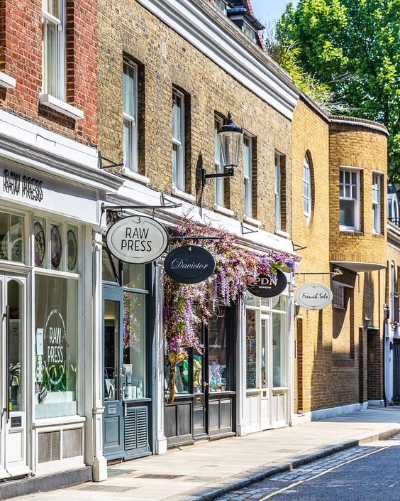 A beautiful street with flowers on the shopfronts just off Sloane Street in London. #flowers #london #floral #shopping #shop