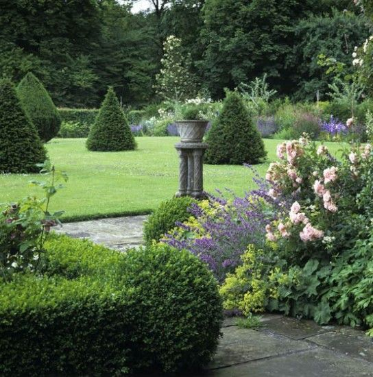 Formal garden yew topiary breaks up a large lawn and, combined ...