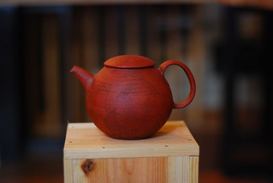 Red Japanese ceramic teapot.: