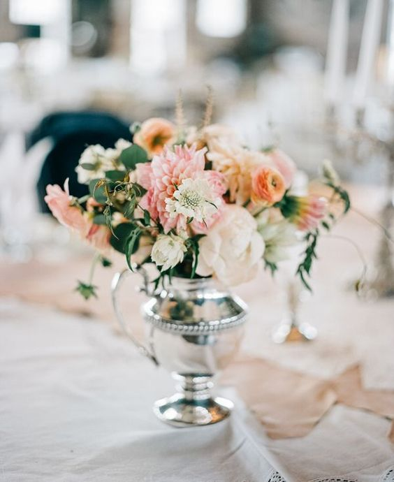centerpiece in sterling silver - photo by Geneoh Photography http://ruffledblog.com/converted-train-station-wedding