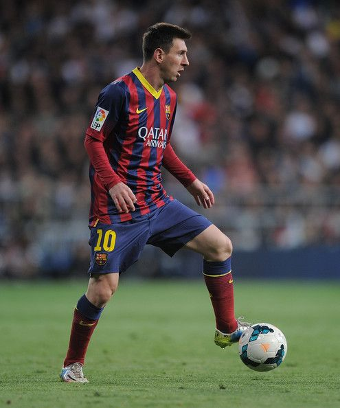 Lionel Messi of FC Barcelona in action during the La Liga match between Real Madrid CF and FC Barcelona at estadio Santiago Bernabeu on March 23, 2014 in Madrid, Spain.