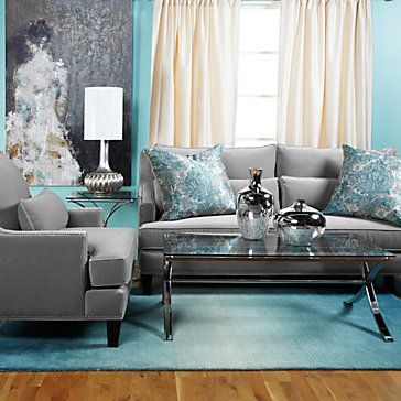 grey couch blue accents