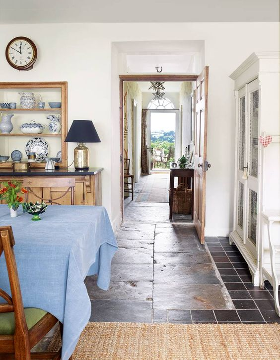 She inherited the blue lias stone floor, the Aga and much of the furniture from the previous owners, but the Regency dining chairs are a more recent addition.