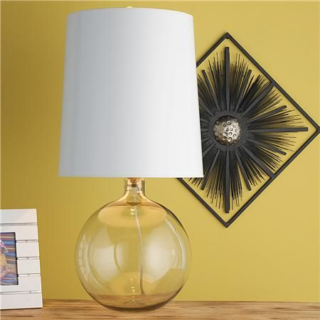 An oversized glossy white paper shade gives this glass sphere table lamp a modern look. The smooth blown glass sphere glistens in the light cast from the oversized shade. $239