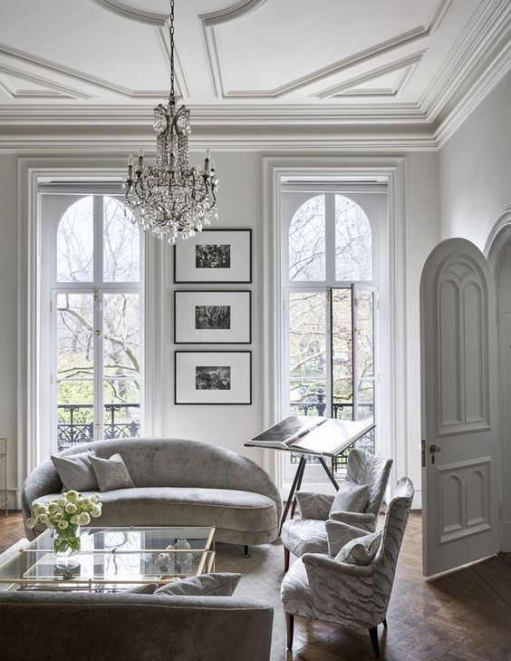 Traditional French Living Room Paris France White Walls And Ornate Molding On The Walls And Ceiling Living Room Interior Living Room Lighting House Interior