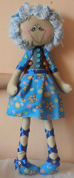 Doll made ​​of denim and cotton.In the middle of the cartridge cushion.Hair of wool.Face painted with paints for fabric.Height about 58 cm