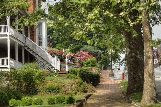 Abingdon, VA Population: 8,206 Surrounded by the Blue Ridge Mountains, you'll find plenty of rivers, lakes, and trails in the town of Abingdon, not to mention a historic downtown filled with restaurants, galleries, and shops. For more information, visit VisitAbingdonVirginia.com.