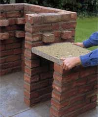 build a grill | set the paving flag on a bed of mortar to make a table top alongside ...