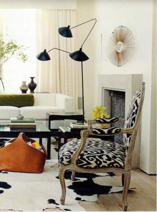 Use bright, shiny, or graphic objects to draw the eye around the room and away from uglier views (TV).