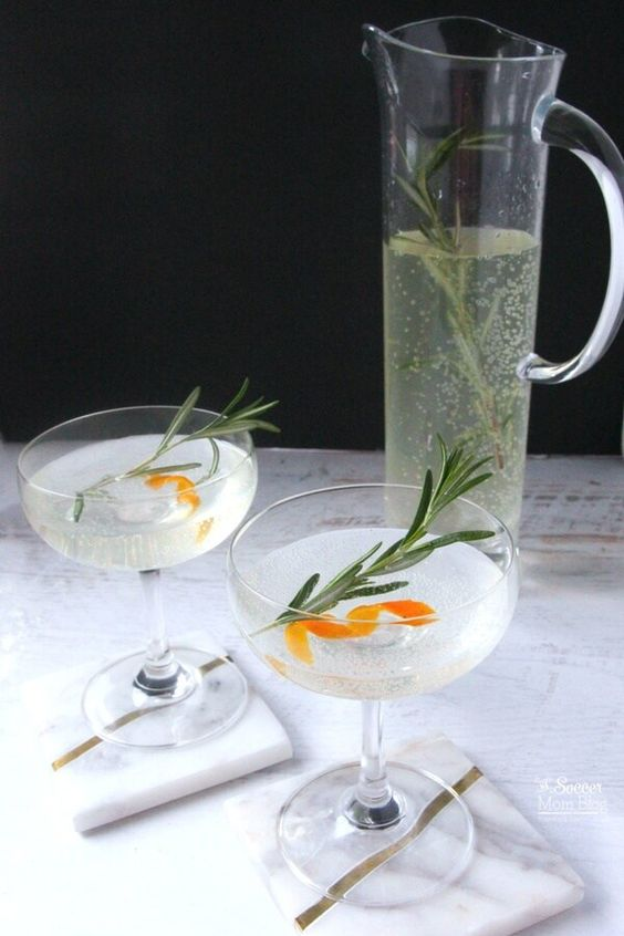 "Move over Mimosas! This Rosemary Orange Vodka Spritzer is the new fizzy ""IT"" drink in town! A refreshing brunch or holiday cocktail with only 3 ingredients.:"
