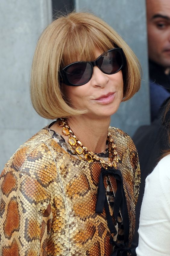 Vogue Editor Anna Wintour...is she pursing her lips?  That must've been some ugly dress.