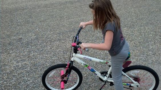 Lily riding her bike