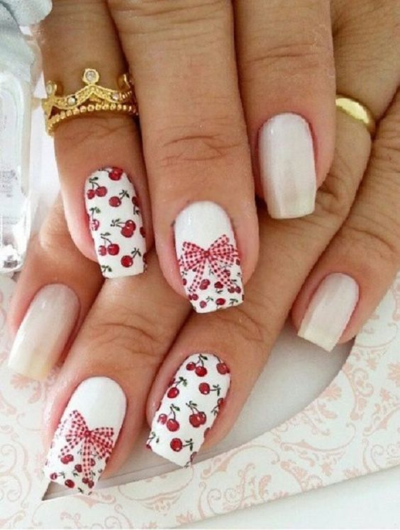 This is a really cute cherry and bow nail art design. The cute little cherry details complement the checkered pattern of the bow used to tie the French tip around the nail.