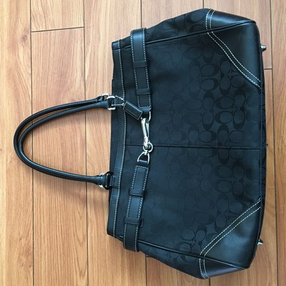 Coach black purse handbag Black coach purse handbag, can carry in hand or over shoulder. Big enough to hold my iPad and MacBook. Great for work travel. Can carry a lot. Coach Bags Satchels