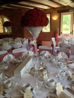 Rose filled martini vase centrepiece