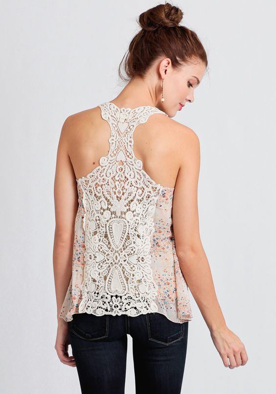 Rendered in sheer light pink chiffon, this lovely top features a floral print.