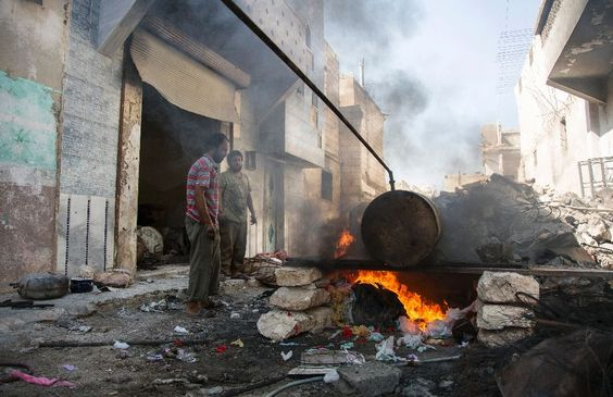 In a destroyed building in Syria's Aleppo, neighbours Abu Ahmed and Mohammed…