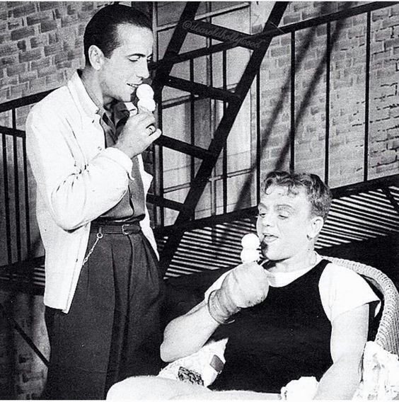 'Tough guys' Humphrey Bogart & James Cagney enjoying ice-cream between takes. -Humphrey Bogart Estate