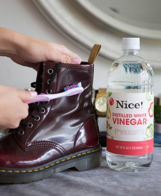 Scrub off water stains on leather boots with a soft toothbrush and vinegar.