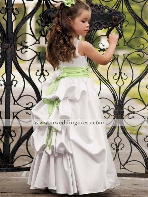 The pickups on this gown give the appearance of a Victorian bustle. The minty green waist sash adds a crisp Spring feel.