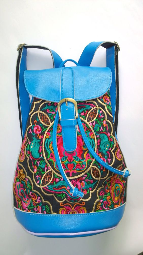 Check out this item in my Etsy shop https://www.etsy.com/listing/213784655/blue-hmong-boho-leather-embroidery-bag