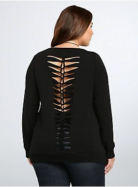 """<p>A cozy black sweatshirt gets a jolt of rock 'n roll flavor thanks to a slashed & braided back that lets you show off a hint of skin. Ribbed trim is meant for defining your shape, the shredded back is for taking a walk on the wild side.</p><p></p><p><b>Model is 5'9"""", size 1</b></p><ul><li>Size 1 measures 27 1/4"""" from shoulder</li><li>Rayon/polyester/spandex</li><li>Wash cold, dry low</li><li>Imported plus size sweatshirt</li></ul>"""