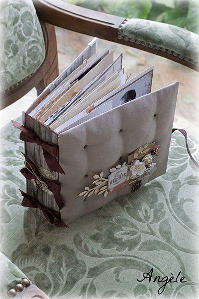 http://fee-du-scrap.over-blog.com/article-un-mariage-en-automne-110494951-comments.html#  J'adore l'effet matelassé de la couverture