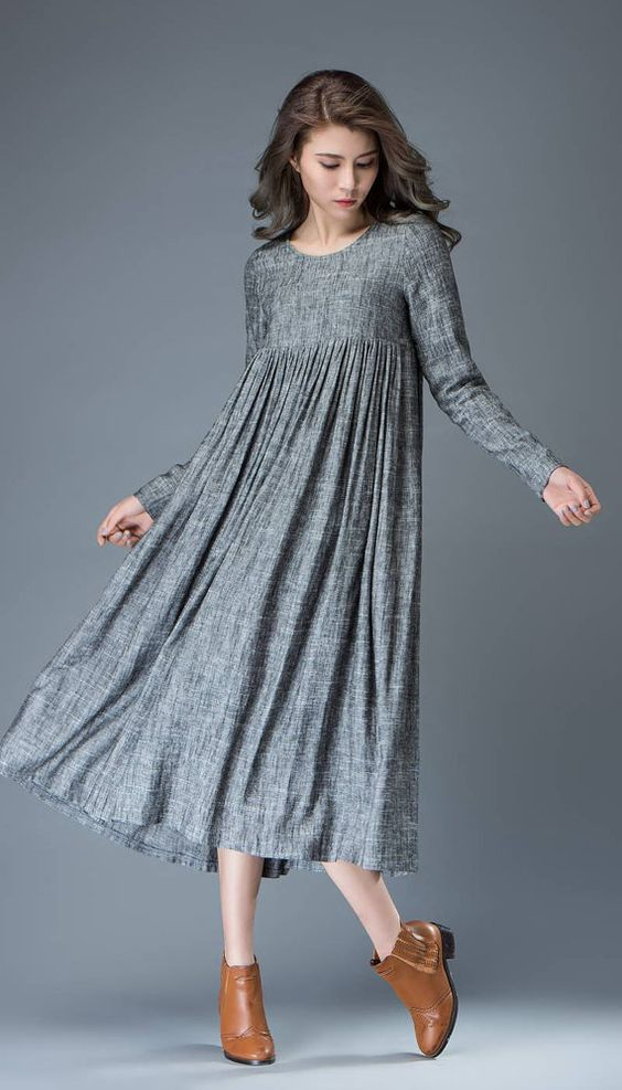 Playful and polished all at once, this simple gray linen dress certainly packs a punch in the versatility stakes. With a round-neck and full length
