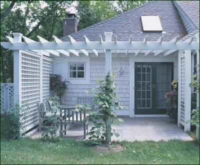 Attached Pergola - To create a semi-private, outdoor seating area close to home, this Pergola extends from the house side with attached lattice panels.: