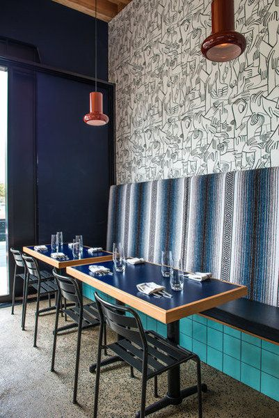 At the Superba Snack Bar in Venice, designers Rebecca Rudolph and Cathy Johnson lined a wall with a custom run of Geoff McFetridge wallpaper...